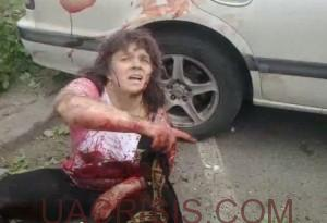 Woman, after Ukrainian army bombing pointing cameraman to where people need help.